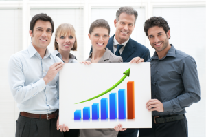 People holding sign with business graph